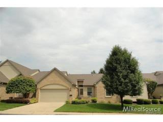 54988  Cambridge Drive  2, Shelby Twp, MI 48315 (#214109395) :: Sine and Monaghan Realtors
