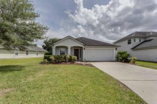 1571  Canopy Oaks Dr  , Orange Park, FL 32065 (MLS #771709) :: EXIT Real Estate Gallery