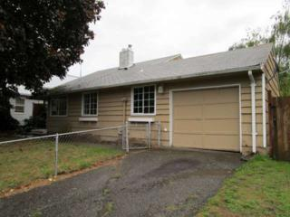 14462  56th Ave S , Tukwila, WA 98168 (#712290) :: Home4investment Real Estate Team