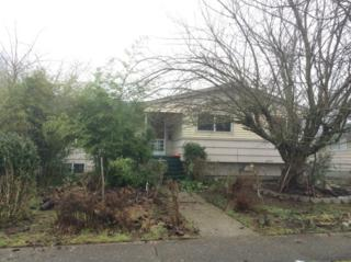4213 S 65th St  , Tacoma, WA 98409 (#736672) :: Home4investment Real Estate Team