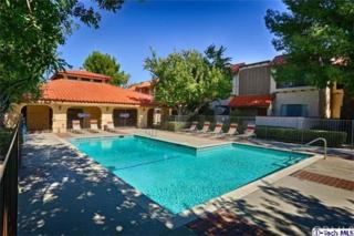 19545  Sherman Way  4, Reseda, CA 91335 (#314032668) :: The Brad Korb Real Estate Group